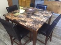 Like new tall square kitchen table and four dining
