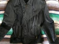 NEVER BEEN USED BLACK- REAL LEATHER with fringe on