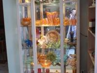 "Beautiful curio cabinet. It is approximately 40"" wide"