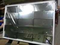 Brand new in the box deco-art mirror. 40' x 60' in