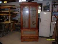 Custom made lighted Gun Cabinet in excellent condition.