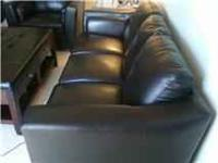 HELLO, WE HAVE A BEAUTIFUL BLACK FAUX LEATHER SOFA AND