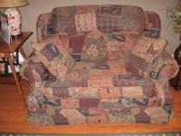 Like new, England brand, loveseat with fold out bed.