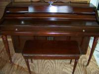 This is a beautiful mahagony spinet piano with bench.
