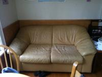 I'm selling a matching beige/tan real leather couch and