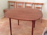Beautiful mid century modern wood dining table.  It is