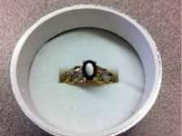 Beautiful brand new garnet and diamond ring set in 10K