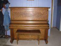Story & Clark solid oak late 1800's upright in very