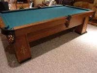 This is a regulation size pool table that is from about