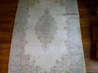 This lovely oriental rug was made by hand in Iran, has