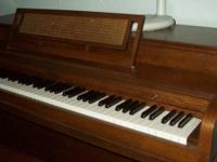 Piano is in great condition, complete with warming rod