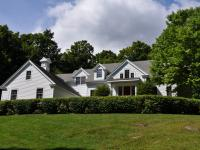 This center hall colonial is located in a prime