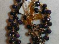 Hand strung purple and gold rosary. Hail Mary beads are