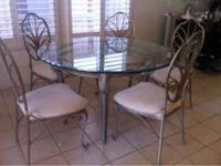 Beautiful elegant round glass dining table with iron