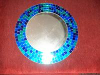 A beautiful round wall mirror, smaller