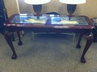 Table is solid and sturdy. It is in very good condition