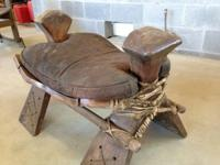 This is a really cool antique leather saddle foot rest.