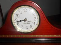 I am marketing a withed timber Seth Thomas Mantle Clock