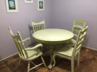 This custom made table and four chairs was originally