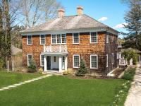 Traditional shingle-style home located on one of the