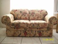 Sofa in good condition. The base colour is taupe with
