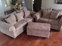 Includes sofa and love seat with matching pillows and
