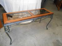 Actually rather timber and metal with glass top table.