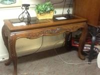 Solid carved wood with 2 glass top inserts $100  10%