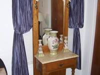 This Beautiful Solid Oak Hall Tree with Mirror and