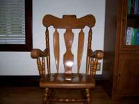 Beautiful solid wood rocker in great shape. Email or