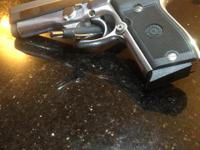 Stainless Steel Taurus PT908 9mm. Great shooter, and