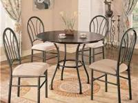 The Halle five piece dining set features a rich dark