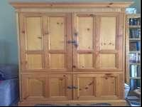 Solid wood entertainment center. Very big. Lots of