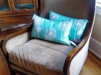 Sturdy curved dark wood frame, gorgeously upholstered