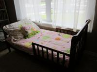 Beautiful dark wood toddler bed with mattress. The