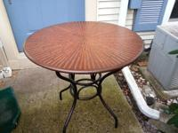 beautiful solid round table with wood inlay stripping.