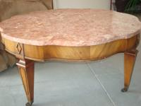 Solid marble top coffee table with ? cherry wood base,