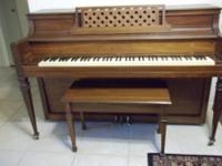 Beautiful Walnut console piano, made by Cable Company
