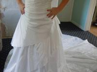 I Have a beautiful wedding dress for sale. Its brandew