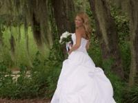 We just got married. Beautiful wedding dress size 4.