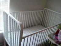White wooden crib with new matress, will disassemble