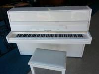 This flawless white upright is a rare find. The piano