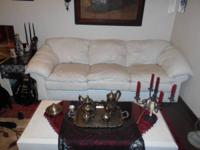 Comes with a white leather 3 seated couch, a recliner,