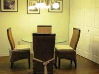 Beautiful wicker dining room table with 4 wicker chairs