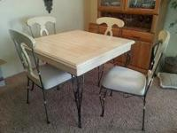 A gorgeous wood and wrought iron dining set, in a cream