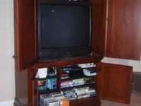Beautiful Dark Wood Entertainment Center for $900.