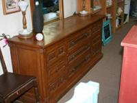 I am selling this beautiful all wood long style dresser