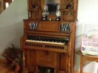 This is a 2 piece, very ornate, non working pump organ.