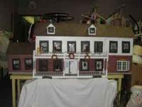 Wooden doll house measuring 6 1/2 feet long, 18 in