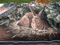 New, never used. This beautiful woven blanket has been